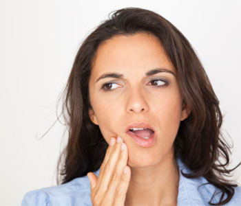 Lady suffering from a toothache