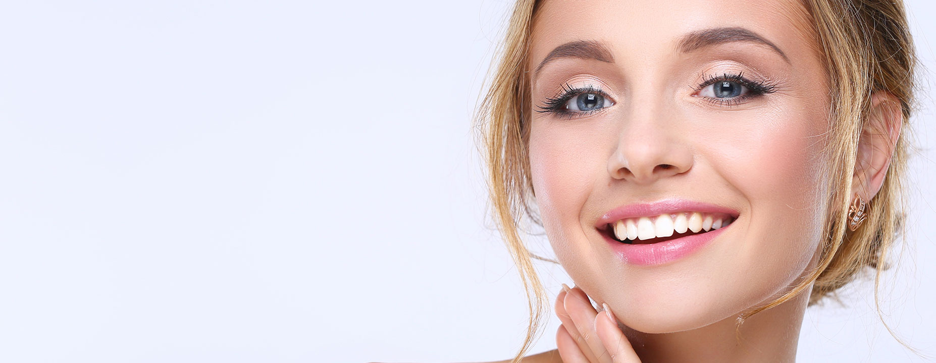 Young lady smiling after having dental filling