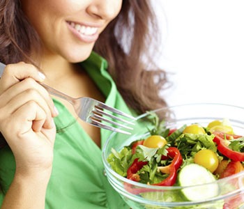 Young lady holding a healthy meal
