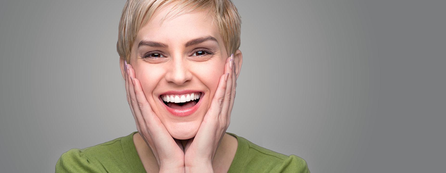Happy lady with a dental bridge