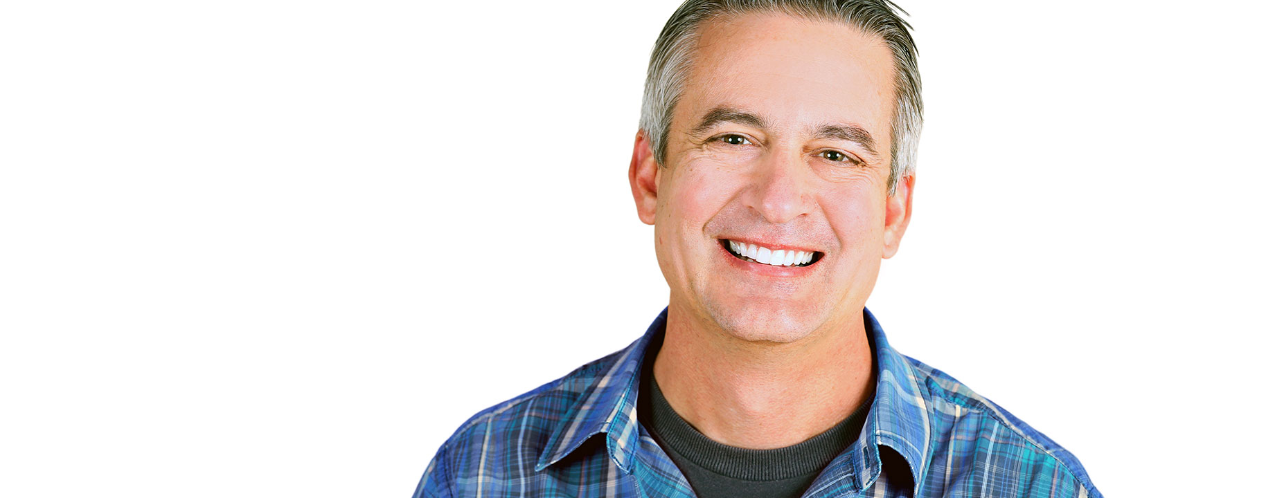 Middle age man smiling after dental implant