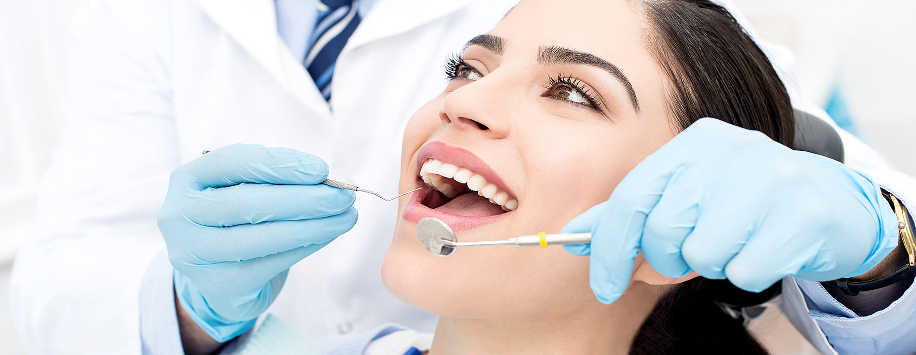 Doctor checking patient's teeth